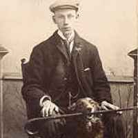 10 - Portrait of man with dog holding walking cane in mouth
