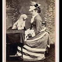 14 - Portrait of woman and dog facing each other.