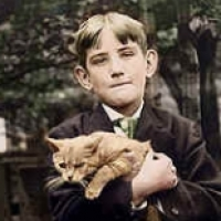 34 - Boy with cat in arms