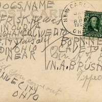31 - Hand writing on b ack of postcard of Frisk, a dog