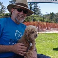 c-loki-with-volunteer-bob-geyer-at-adoption-event