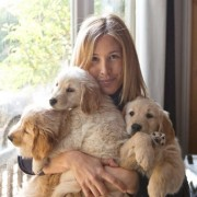 Sharon Montrose and three puppies