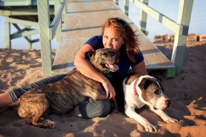 Lori at the beach with her canine family (c) 2013 Darrell Fusaro. All Rights Reserved.
